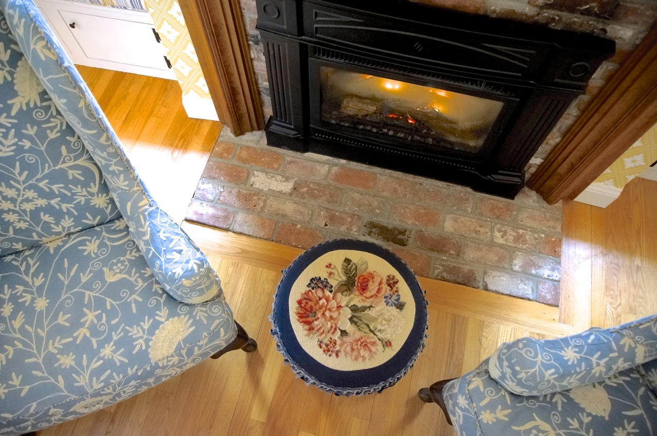 Needlepoint Foot Stool and Fireplace.jpg