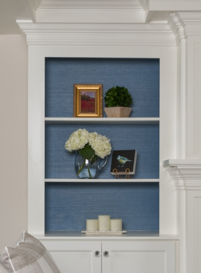 Bookcase is lined with  Ralph Lauren Wallcovering, Marin Weave, Hyannis Blue