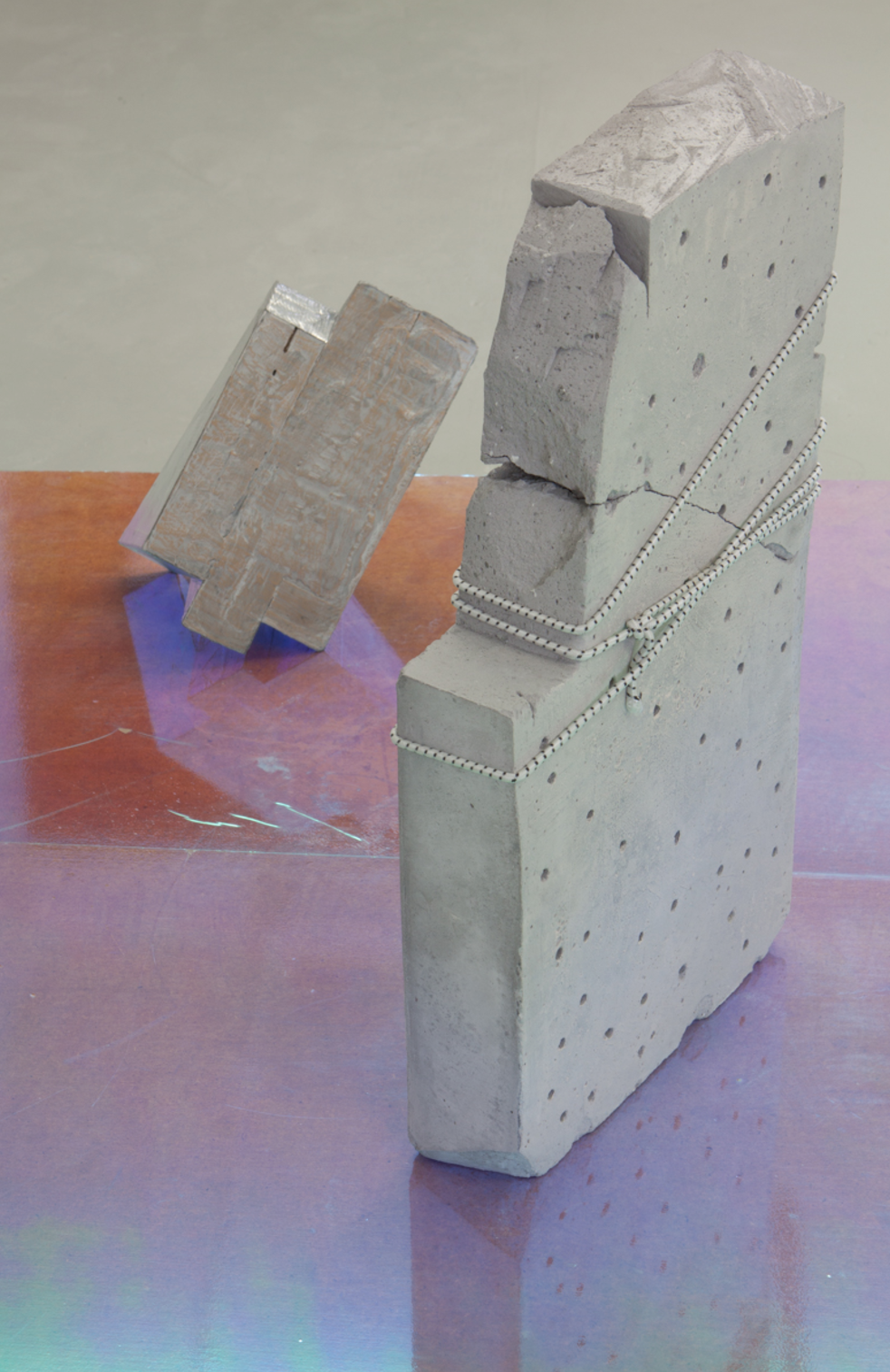 more human than human, 2016. holographic film, MDF, cement, bungee cord, duct tape, plaster, wood, crayon. 4x4' platform