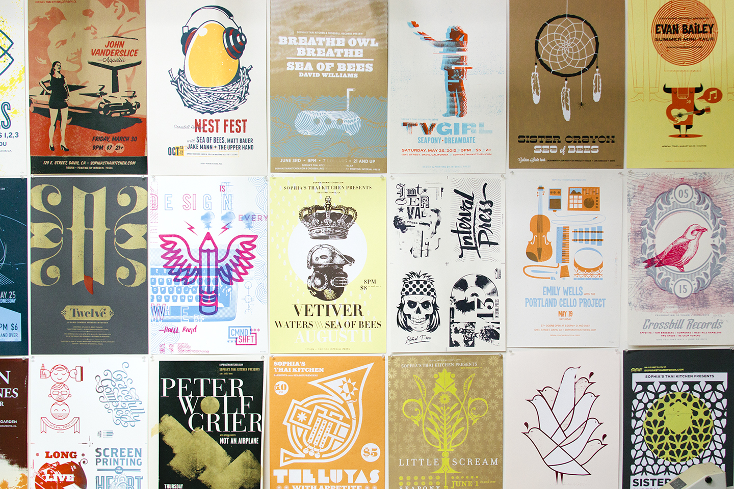 Fantastic screenprinted gig posters covering Interval Press' studio