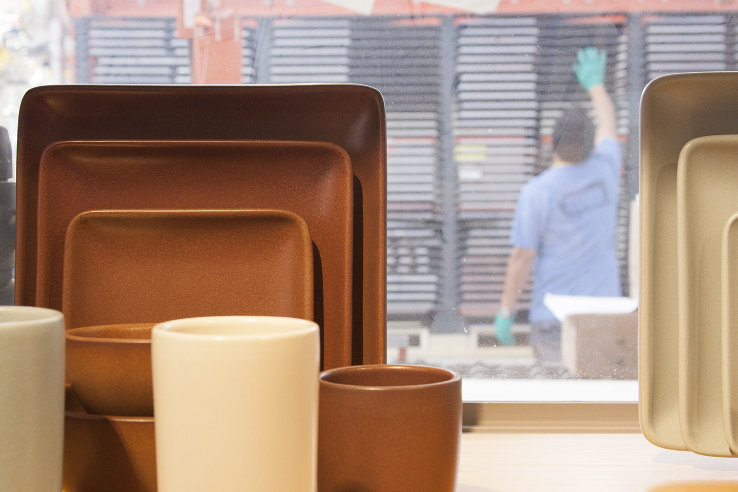 It's so fun to see the factory space through the windows behind the finished products.
