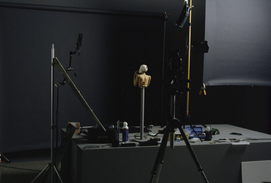 Artist Elizabeth King's studio (1997) set up for photographing:      Elizabeth King,     Pupil ,1987-90     Porcelain, glass eyes, carved wood (Swiss pear), brass. Half life-size.    Dimensions vary: eyes and all joints movable.          Courtesy the artist