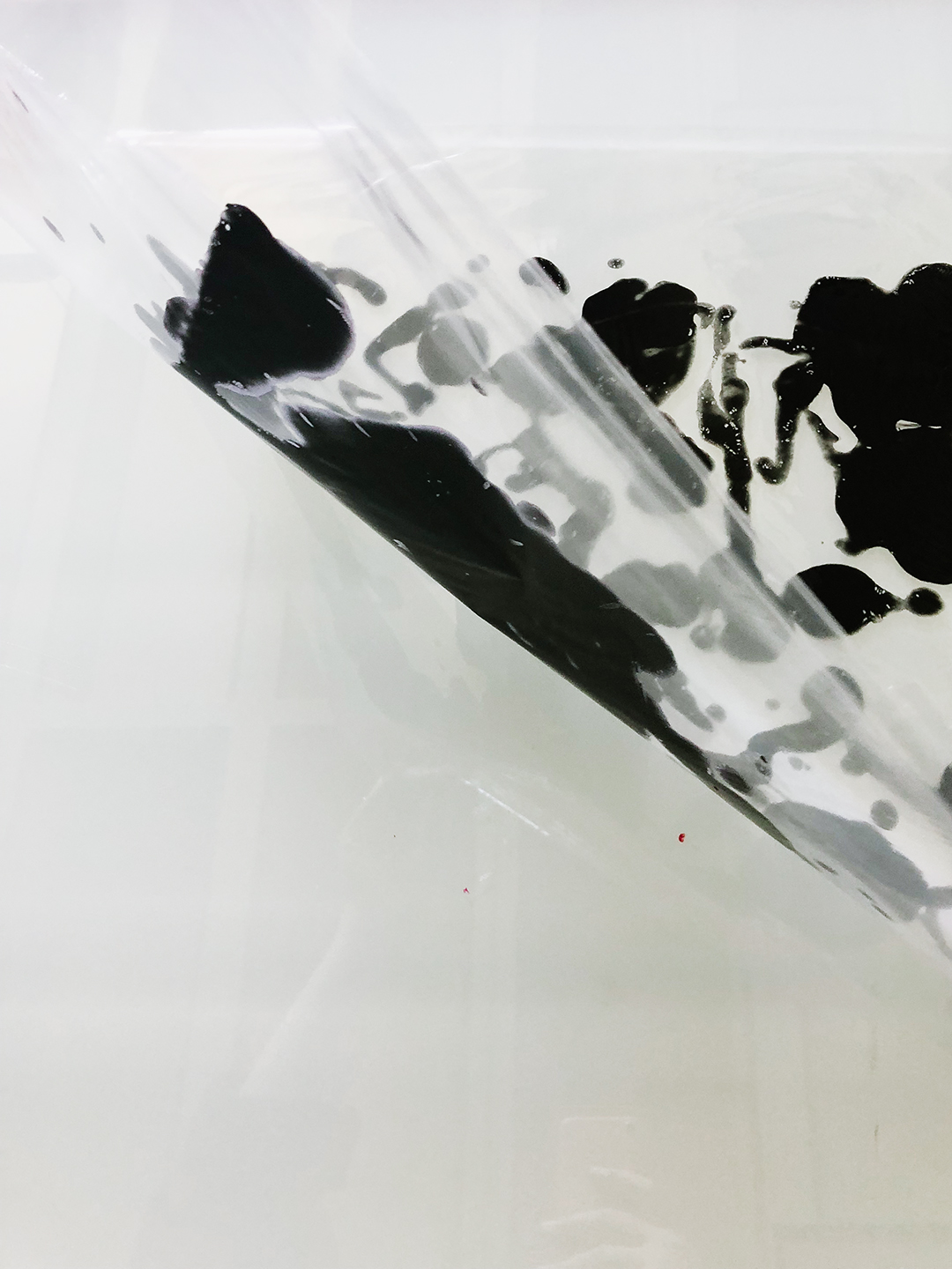 We swished black acrylic paint between sheets of plastic then exposed them as separations directly to the screen.