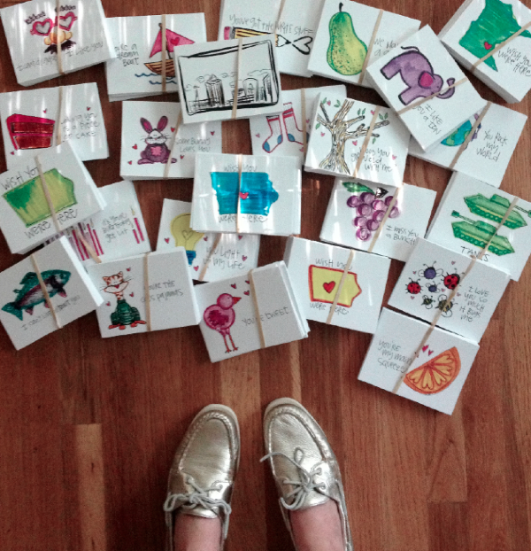 This is what 1,500+ postcards look like.. They are no longer on the floor. Those are also my favorite shoes poorly laced.