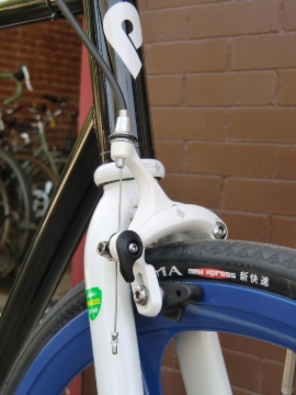 white front brake with white fork to offset the blue wheel set. he is running a freewheel