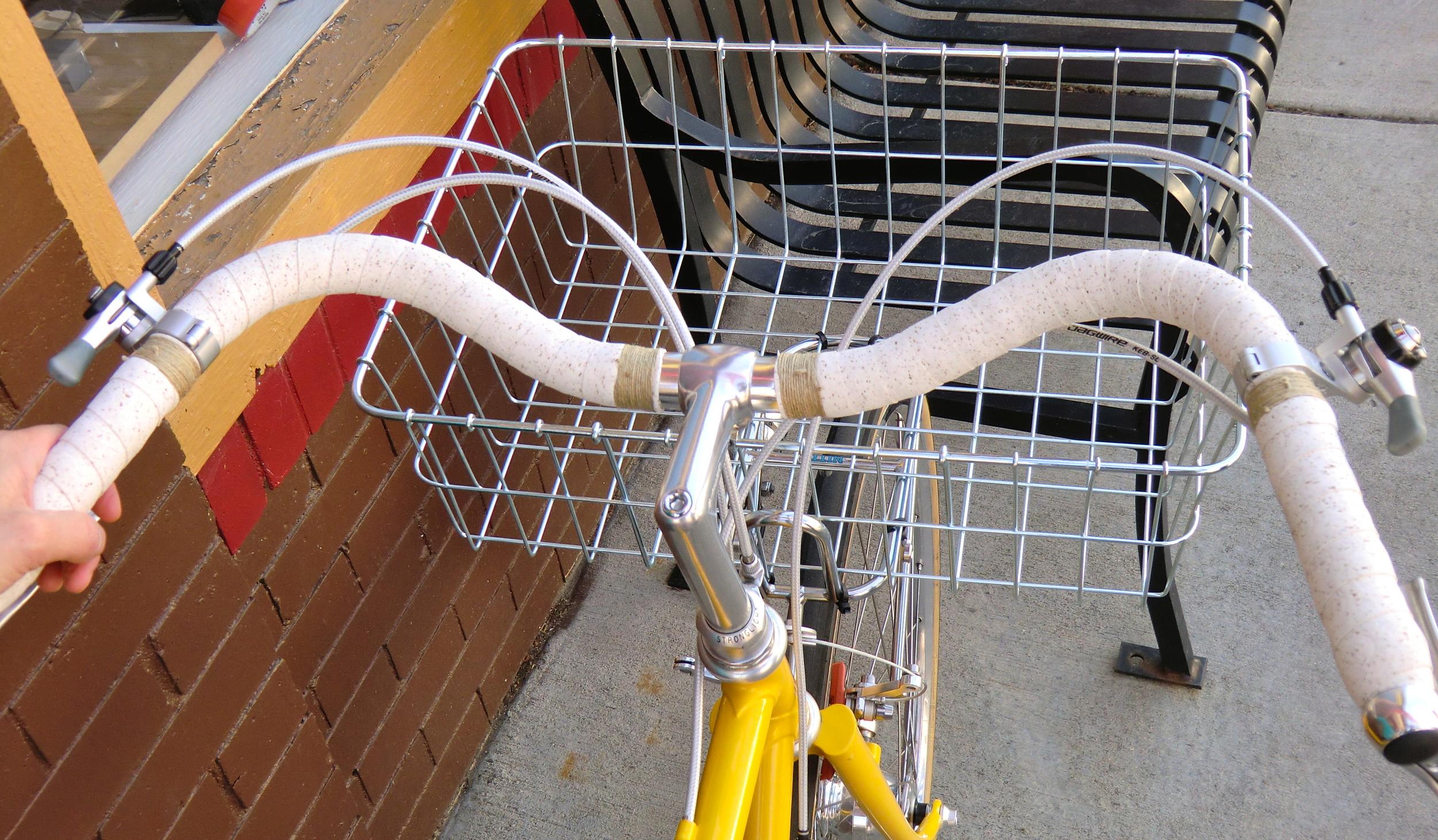 Soma Sparrow Handlebar,  NITTO front rack,  Wald front basket, Cork & Hemp bar wrap, IRD shifters, Jagwire housing