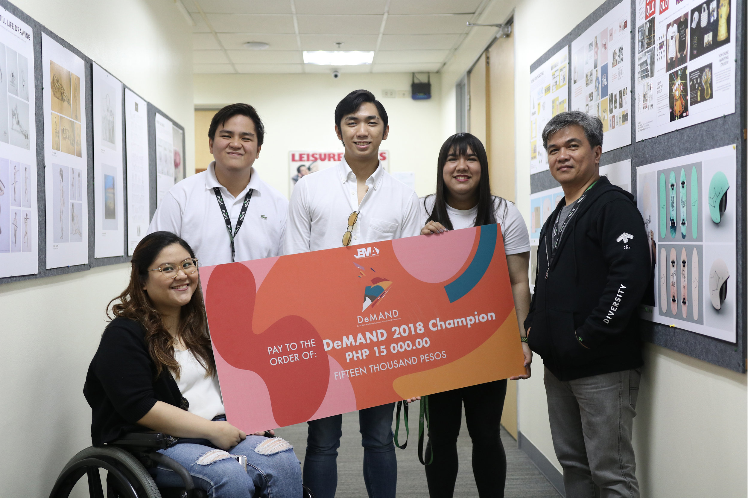 MINT Junior Marketing Association (JMA) were grand champions at De La Salle University Manila's marketing competition, DeMAND. It is sponsored by BAYO. They won the grand prize with their business pitch of having BAYO collaborate with local artists and small businesses to sustain the products they sell.
