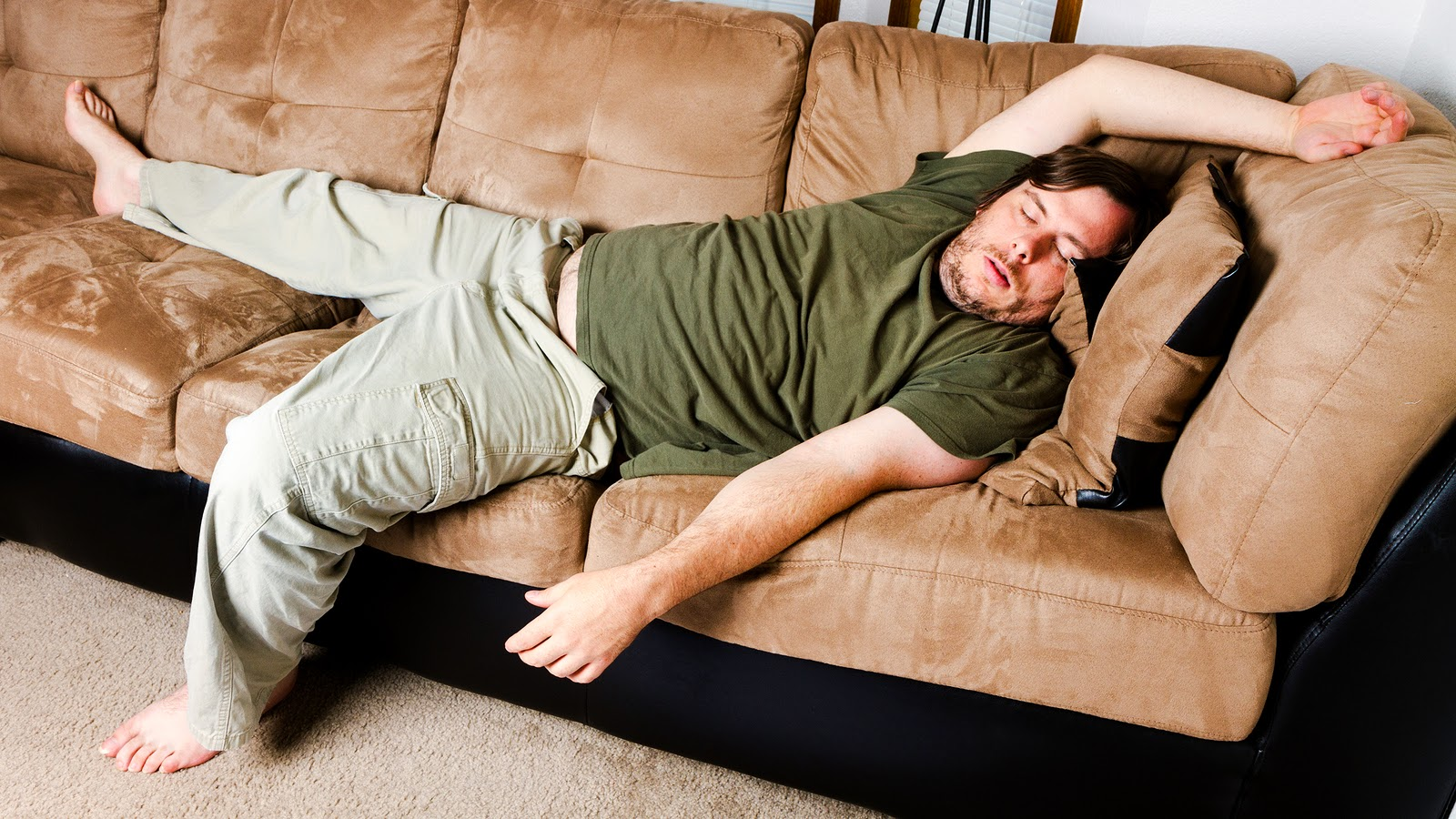 sleeping on the couch- not good for your back or neck.jpg