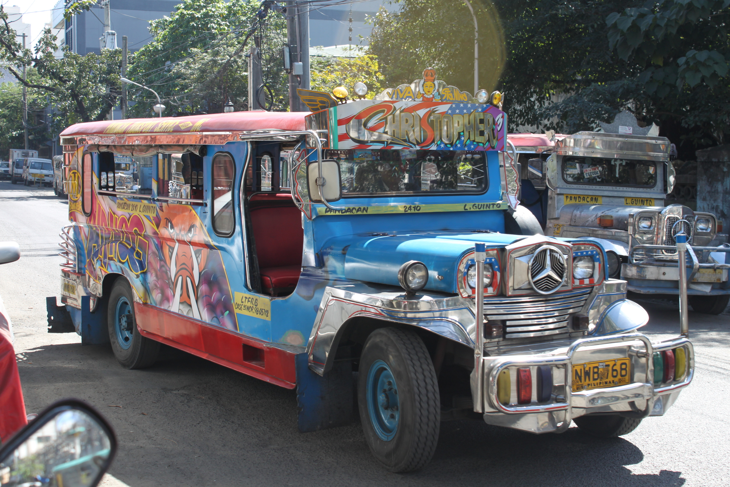 one of the many jeepneys that dot manila's streets.