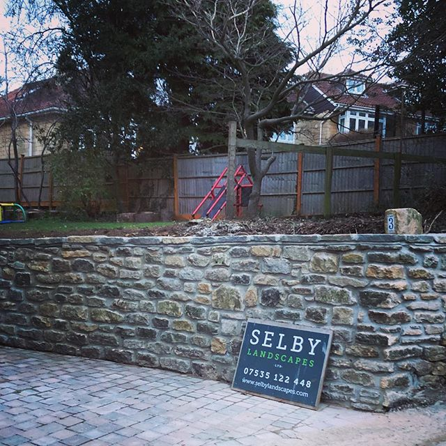 Driveway widened and new reclaimed bath stone wall. Good work @spencercarkeet #reclaimed #bath #landscaping #takeuchi #driveway