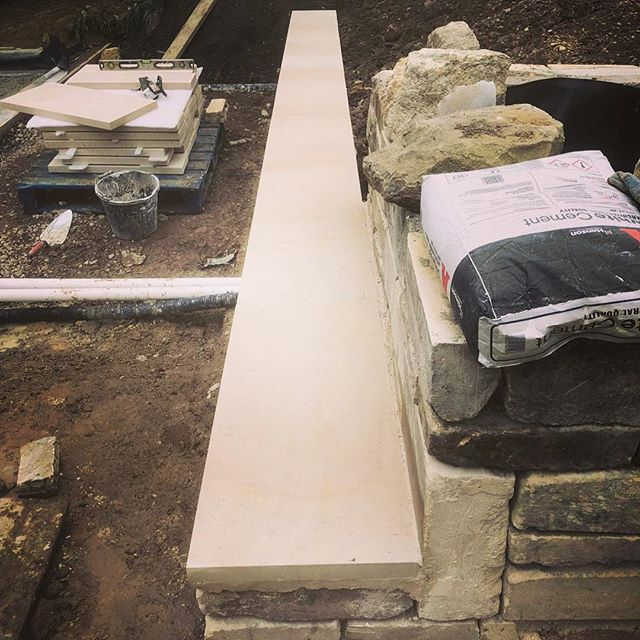 A pic from @englishmountainman on one of our current projects. Bespoke bath copings going on our walls and natural swimming pool. #naturalswimmingpool #bathstone #copings #landscaper #spring