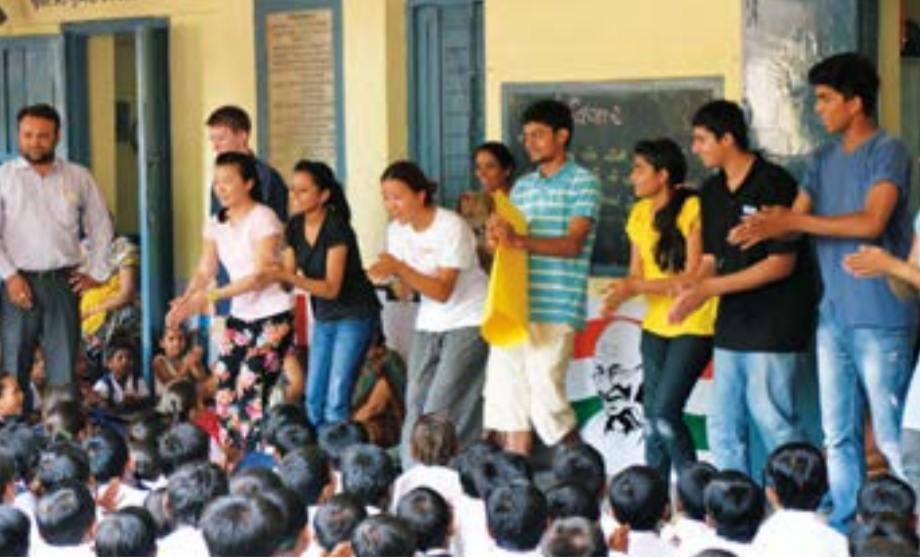 """Indian schoolchildren gather for anassembly to watch Niswarth and Riversidestudents perform their """"Wash Your Hands""""song in Hindi. They soon joined in the fun."""