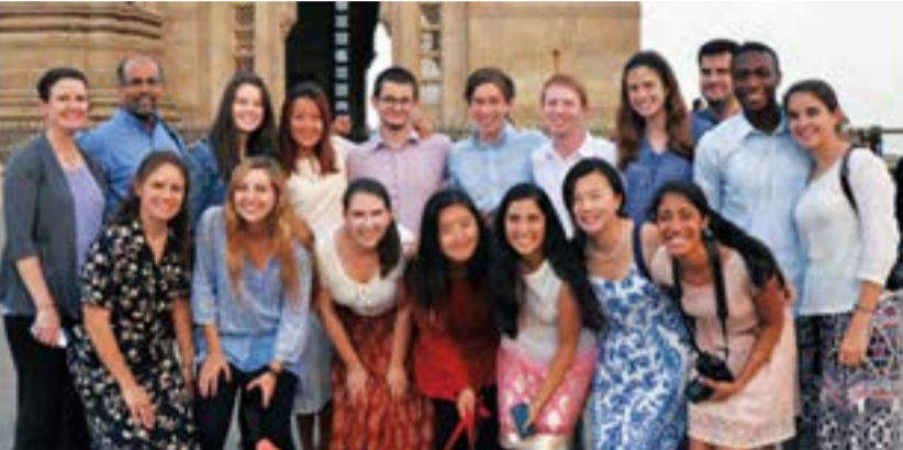 A rare group photo opportunity at the Gateway of India in south Mumbai. Front row, from leftPEA Dean of Studies Laura Marshall, Isa Tejera-Sindall '15, Caroline Hoskins '15, Jenny Wang '16,Mihika Sridhar '16, Kimberly Dawes, PEA '15, and Arzu Singh '16.Back row: Andover Institute DirectorCaroline Nolan, Niswarth Director Raj Mundra, Thea Rossman '15, Rhaime Kim '15, Cem Vardar '15,Jonathan Regenold, PEA '15, John Gorton '15, Maddie Logan, PEA '15, Niswarth and Andover facultymember Andy Housiaux, Nick Madamidola, PEA '16, and Claire Glover '16.