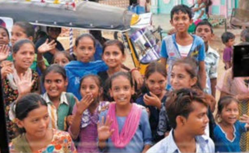 Schoolchildren gathernear the Niswarth students' busto offer an enthusiastic send-off.