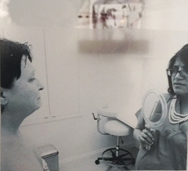 Artist: Annalisa Iadicicco. Medium: photograph printed on transparent photo paper and installed on a reclaimed window. New York, New York, 2015. The artist's mother is pictured here, with Dr. Devgan.