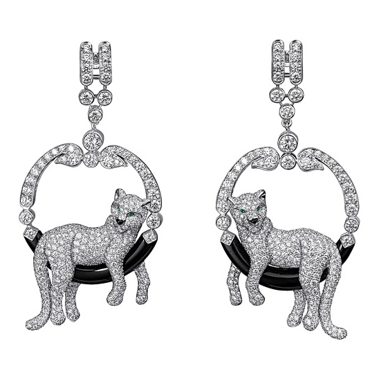 Cartier panther earrings in diamond and emerald.