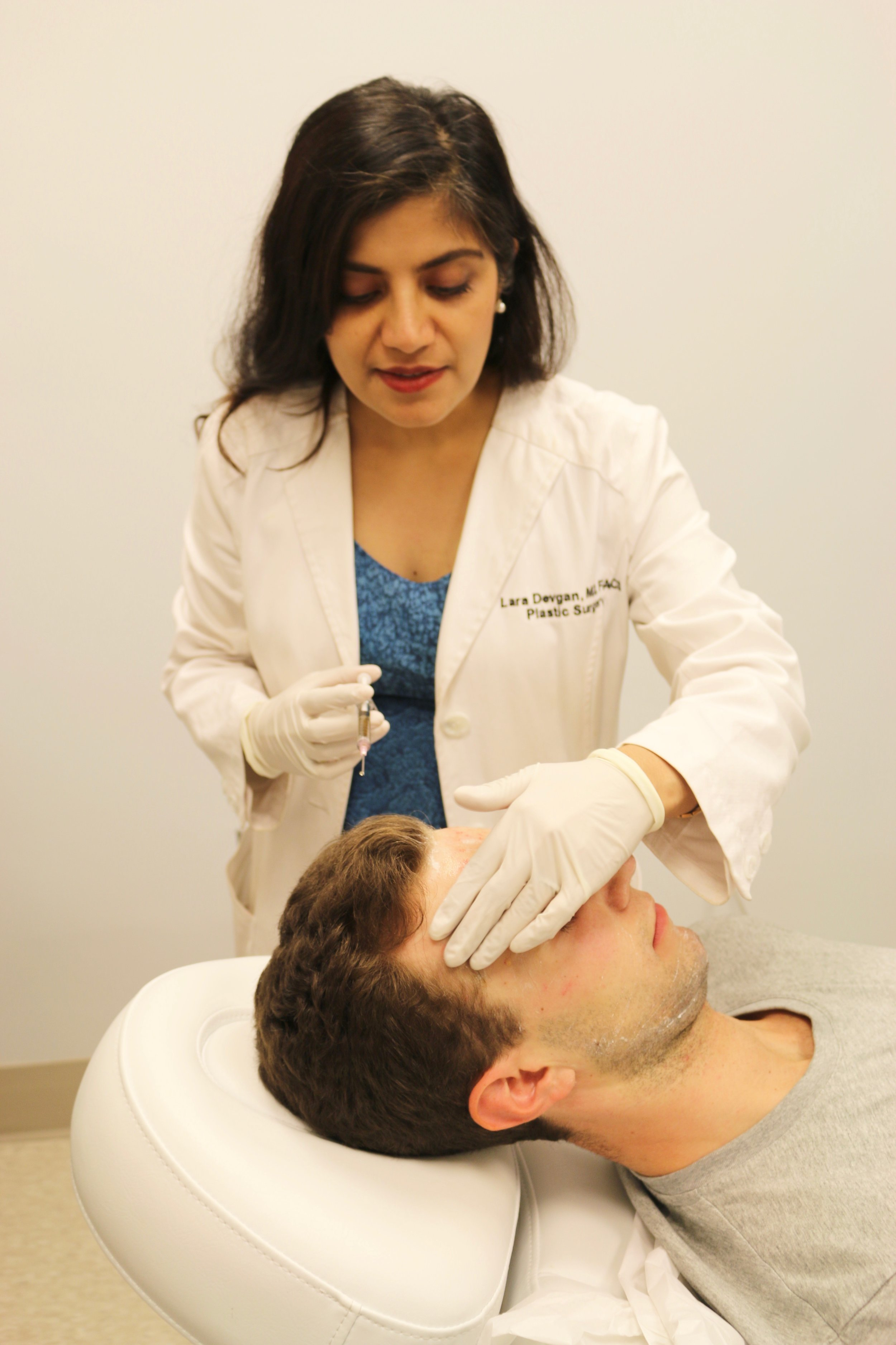 Dr. Devgan with a patient in her New York City office