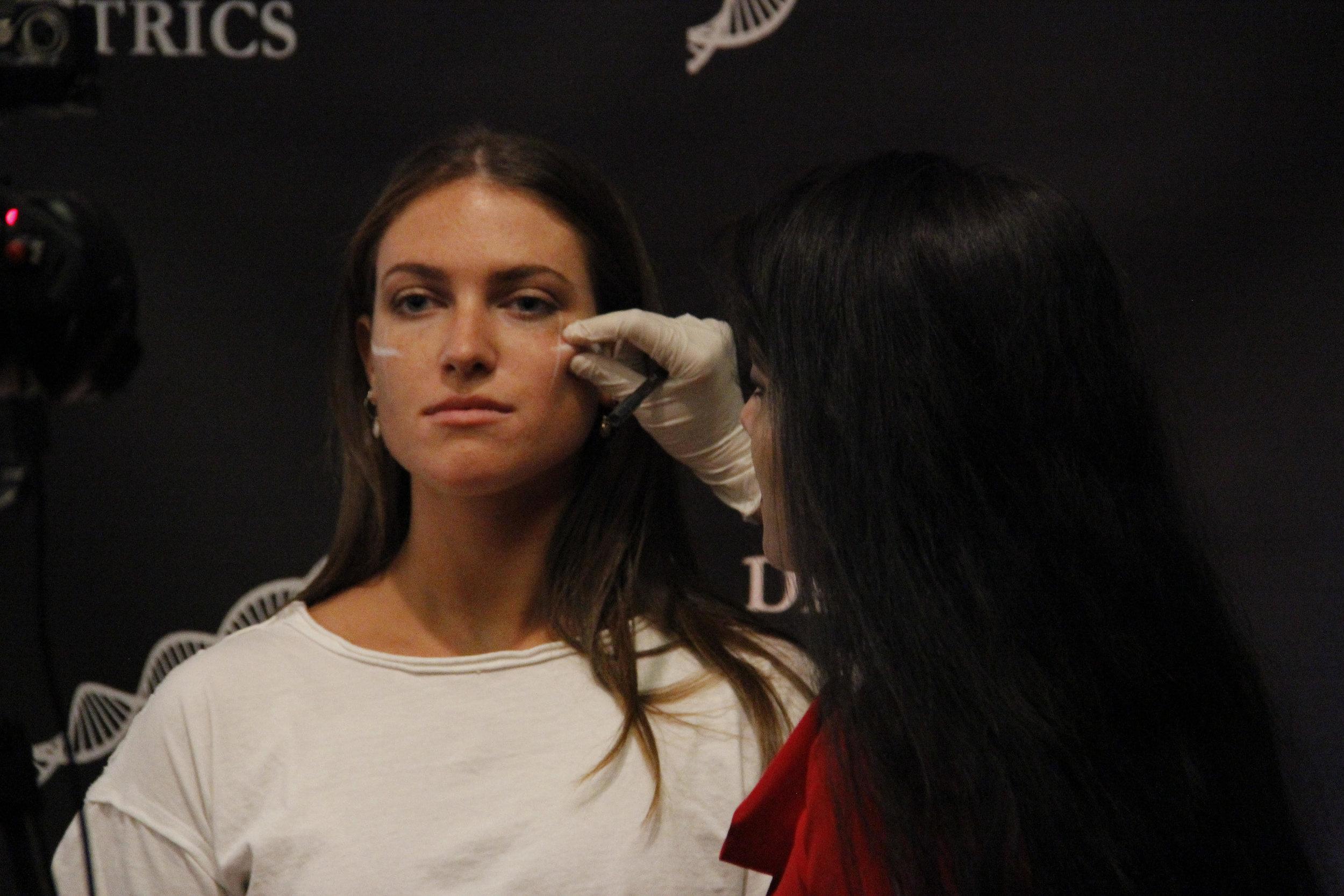 Dr. Devgan marks her patient receiving a jawline augmentation.