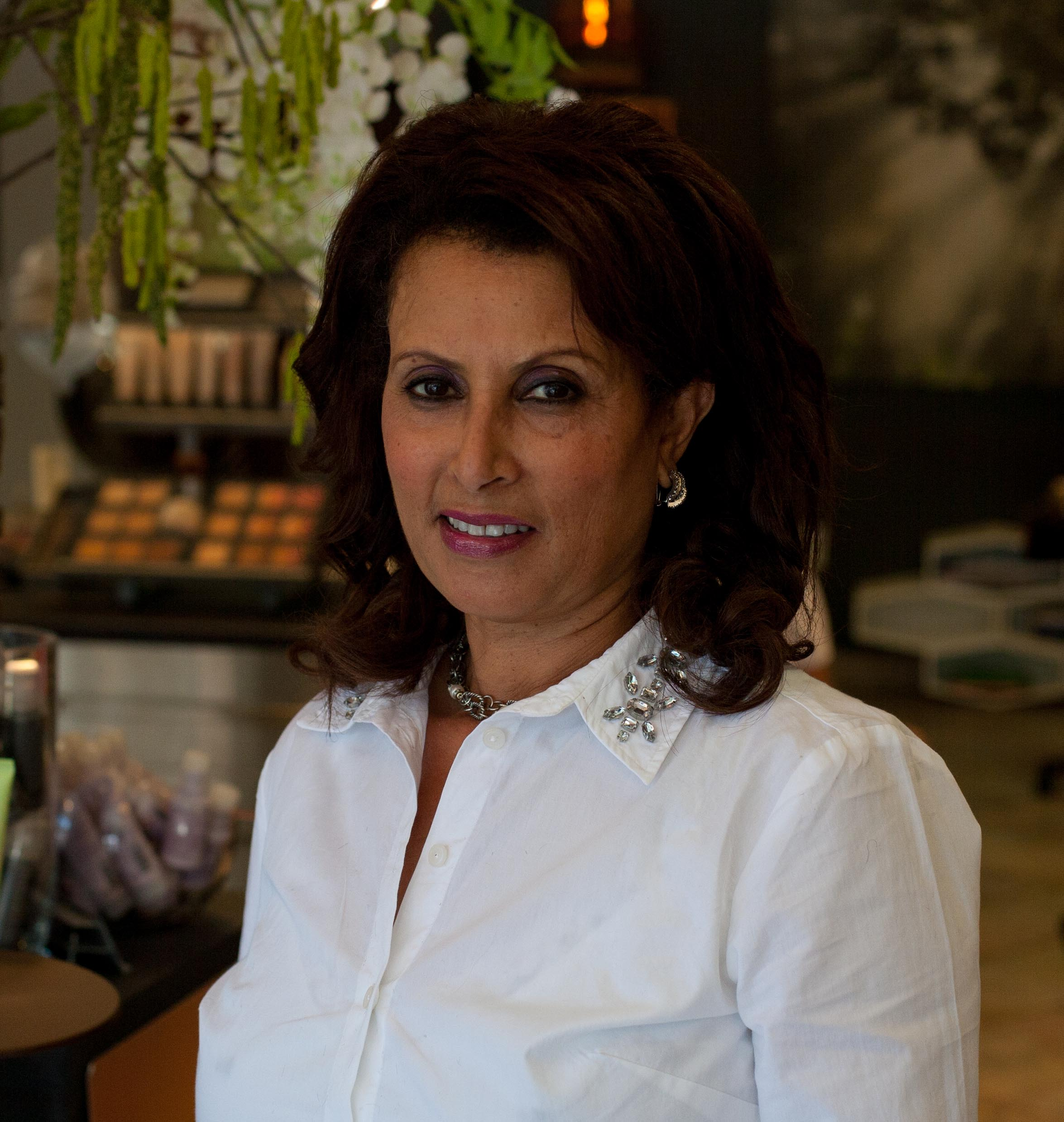 Asrate - With over fifteen years in the industry- Asrate has fully mastered styling techniques. She gets excited about elegant up-dos and iridescent, dimensional color. As a licensed aesthetician, she loves the effects of Aveda's exfoliation.