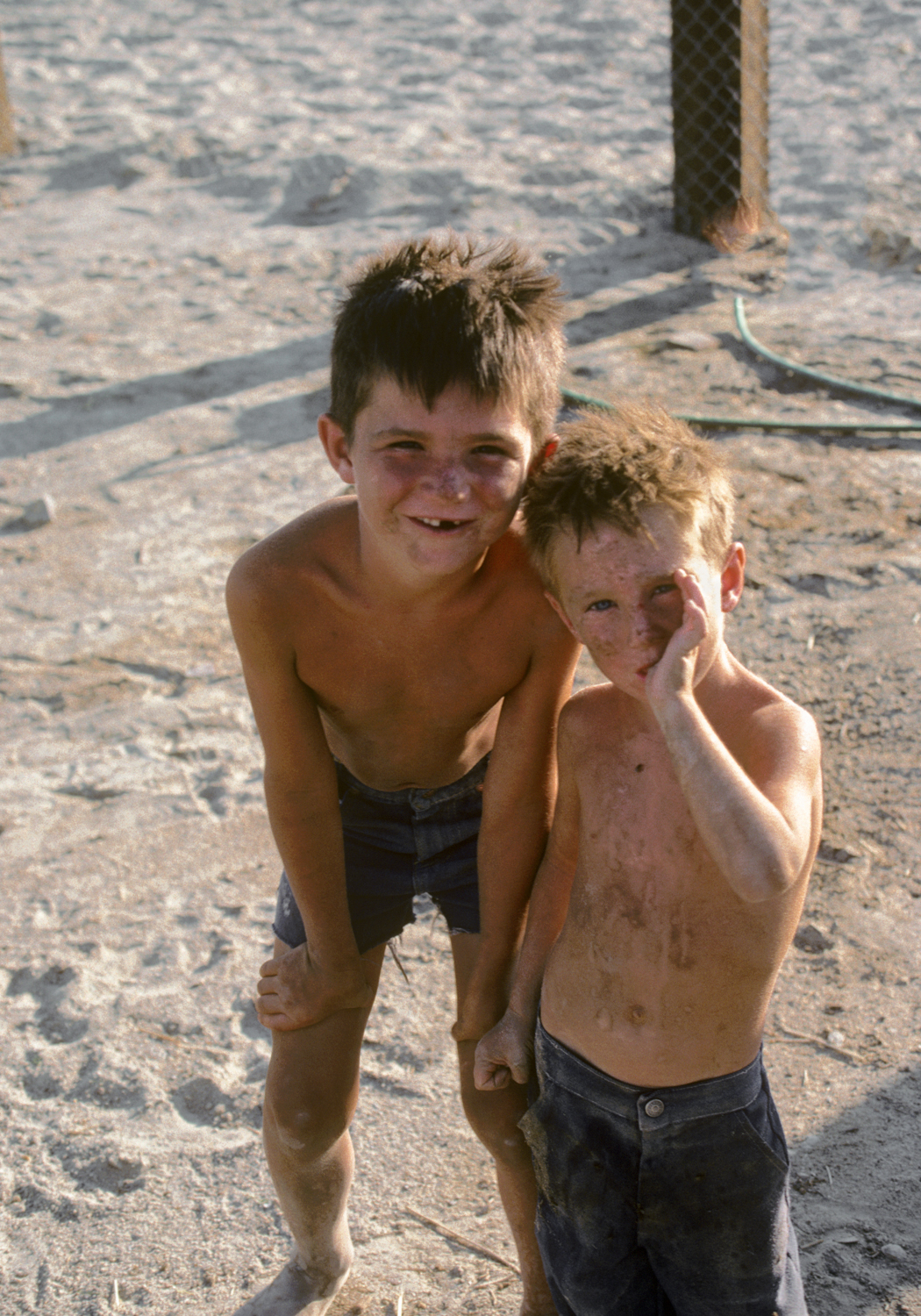 Gene's boys were tough, with bodies that were getting weathered. No shoes. No sunscreen. Like their dad.