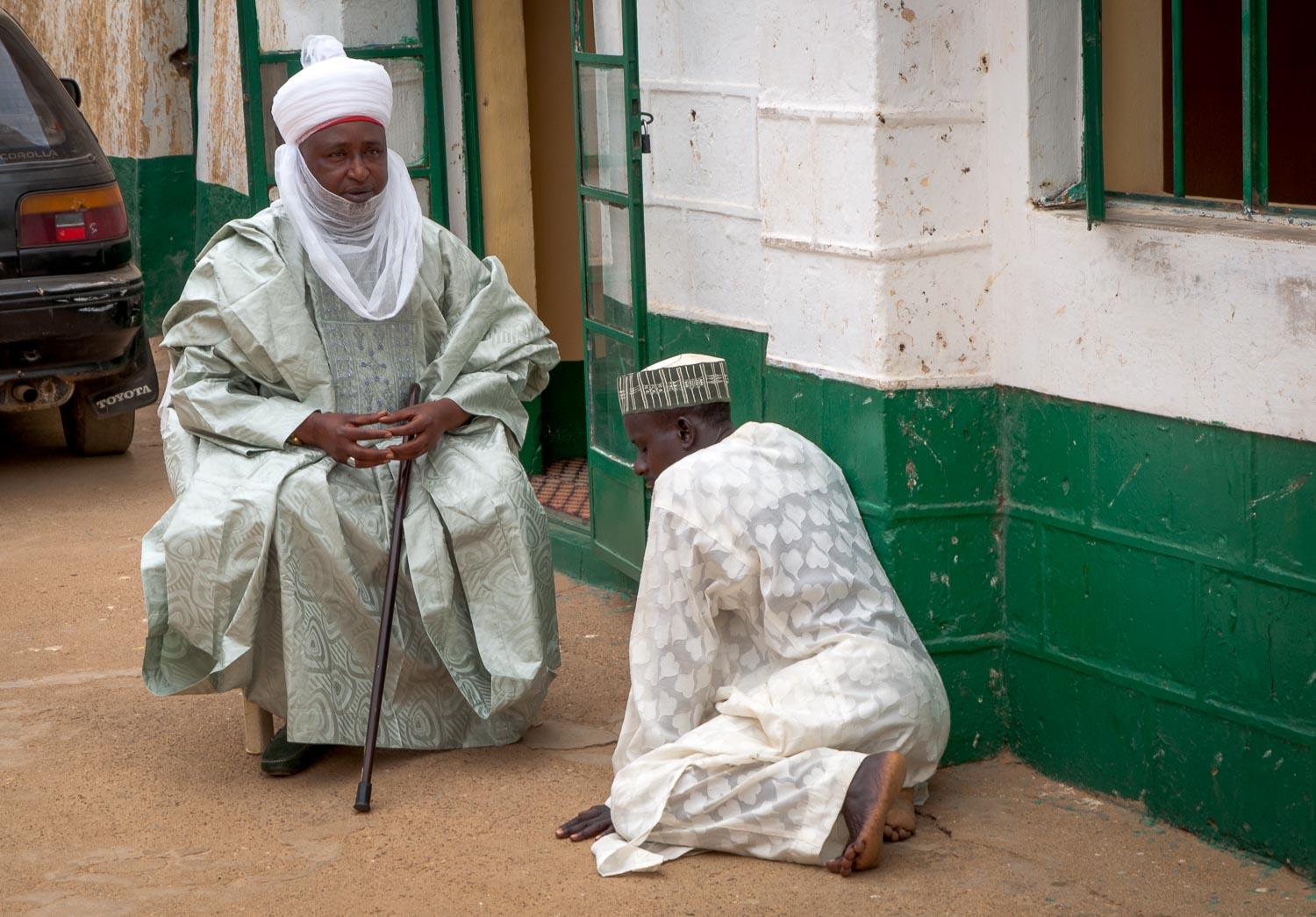 """When speaking to a """"District Leader"""" (all members of Kano's Royal Family) everyone but a westerner must bow and avert their eyes."""