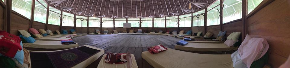 Inside the ceremonial  Maloca,  where the shaman's healing plant medicine-based ceremonies take place.