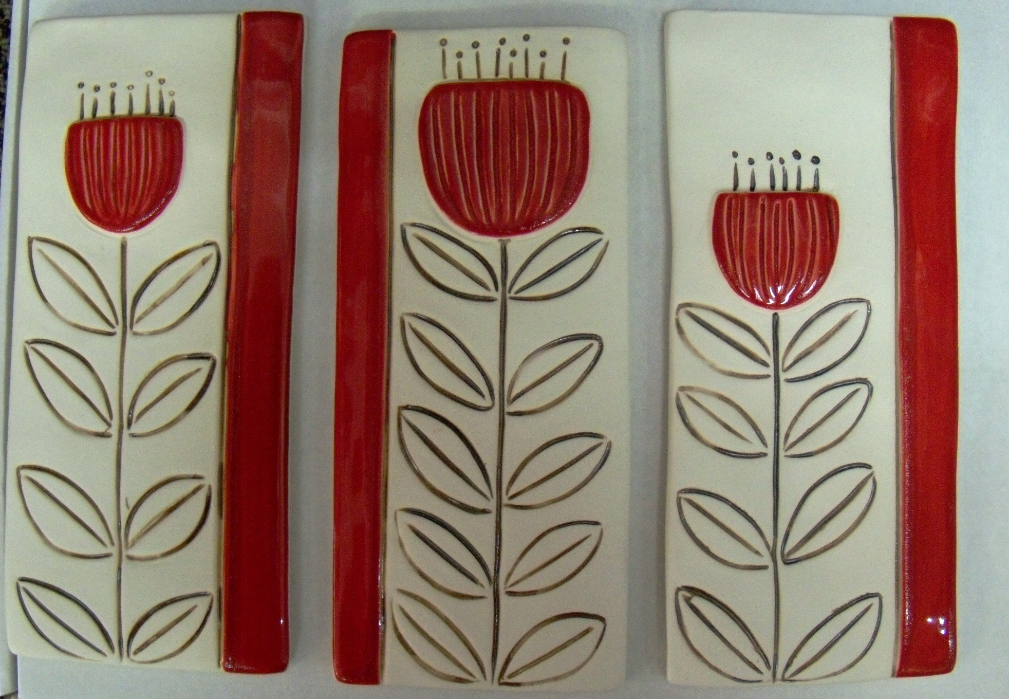 Pohutukawa Tiles $99 White with red and gold decoration. Each tile measures 100mm w x 230mm h Comes boxed