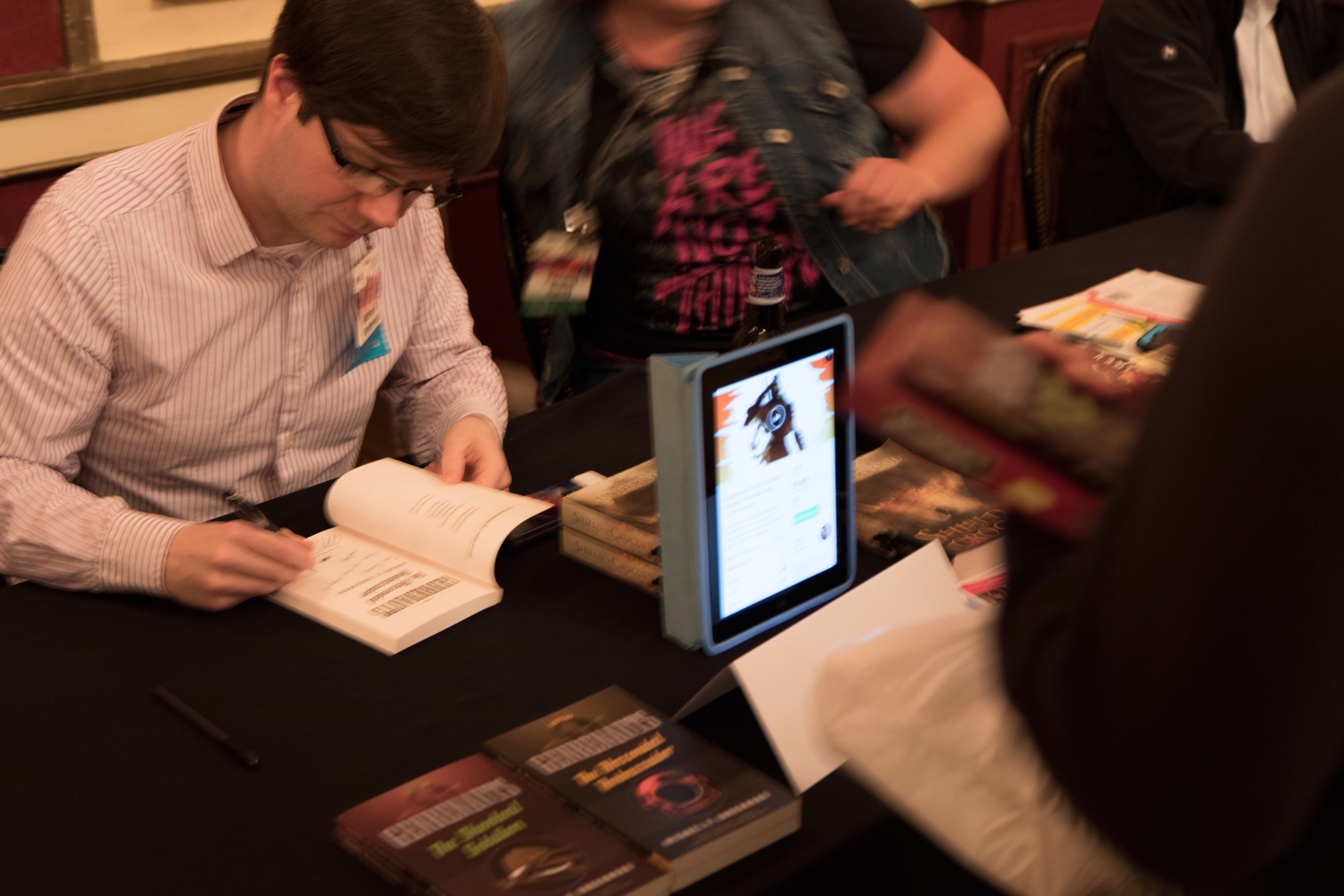 Walking the walk: At the author signing Mike attracted attention to his table using an ipad displaying his active kickstarter.