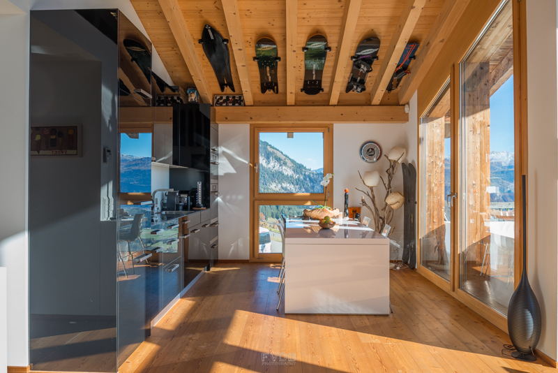 Even the kitchen is overlooked by the extensive snowboard collection