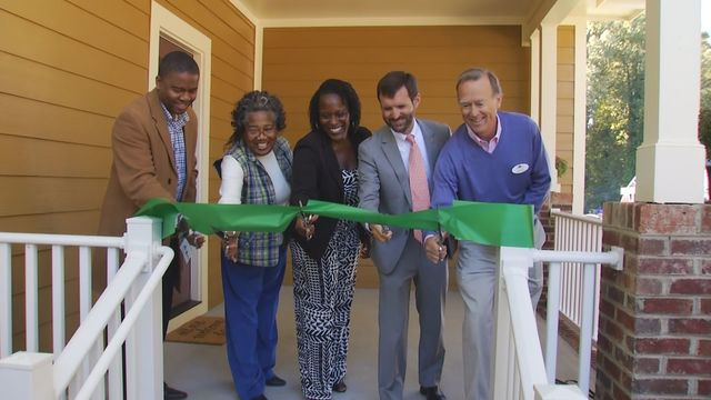 Ribbon cutting for two new affordable rental properties attended by leaders and residents Image Credit: WSPA CBS 7