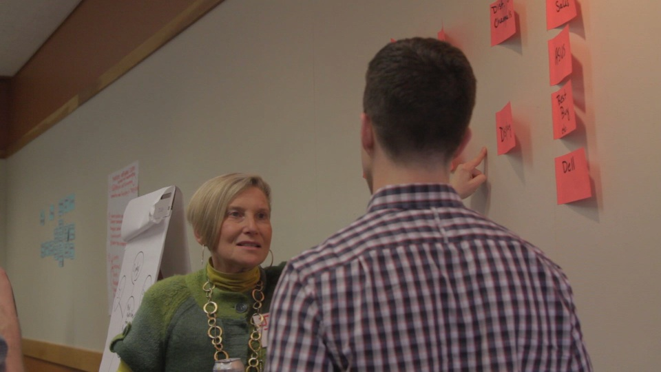 Judy reviewing a value chain with a workshop participant.