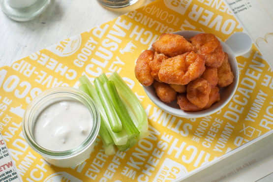 Buffalo Cheese Curds = Wisconsin Cheddar curds, Black River Blue Cheese dressing & celery