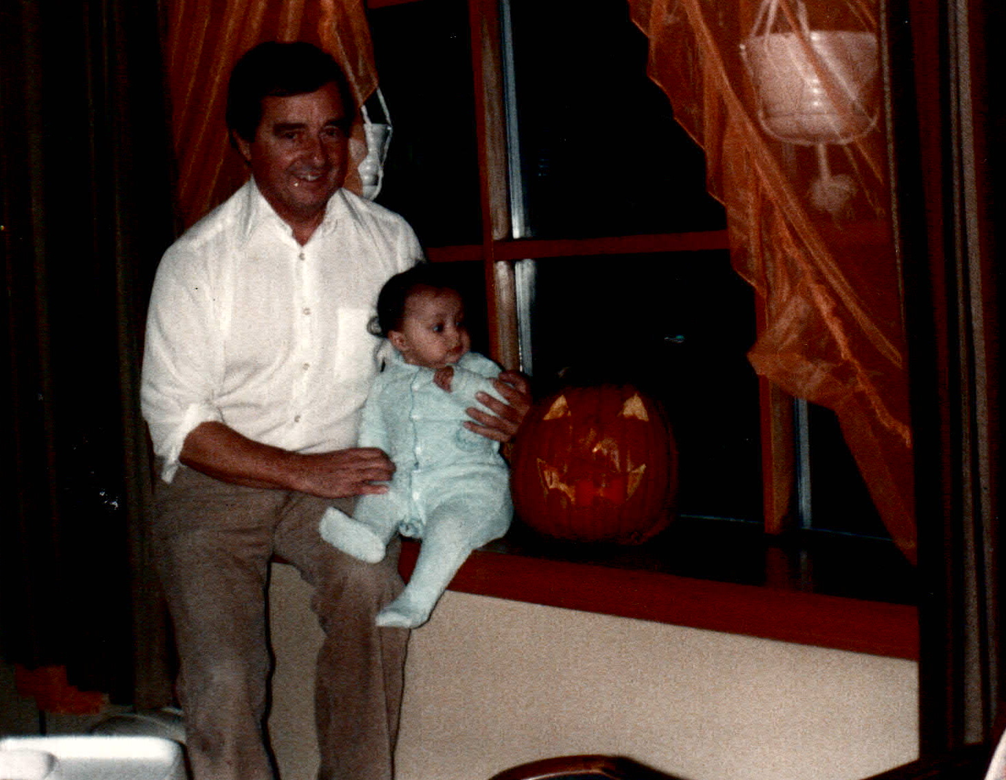 Dad & baby me being horrified by Halloween