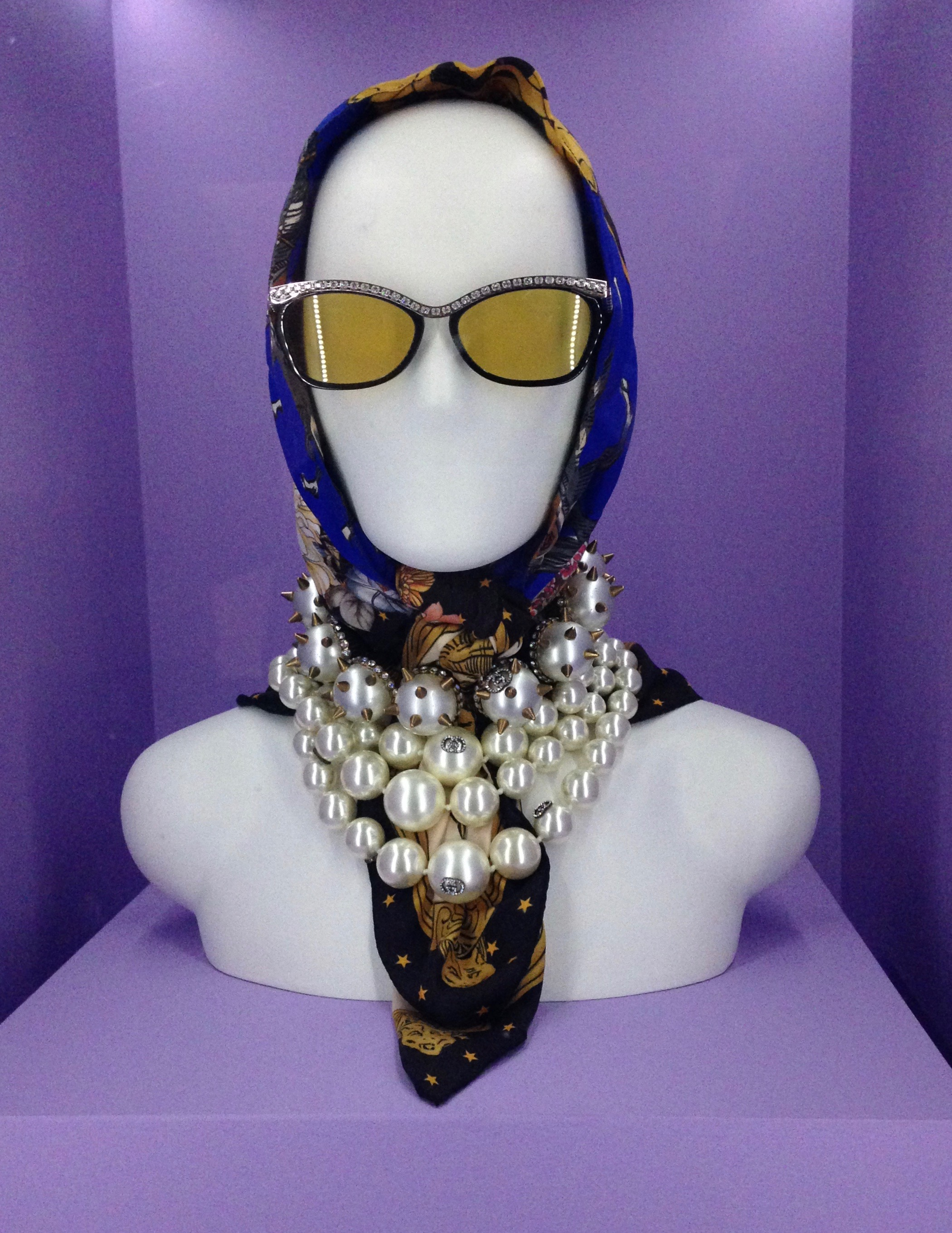 Gucci, Accessory Set, pre-fall 2019, scarf of polychrome printed silk twill; glasses of black and yellow synthetic, clear crystals, and metal; necklace of pearl beads, clear crystals, and metal