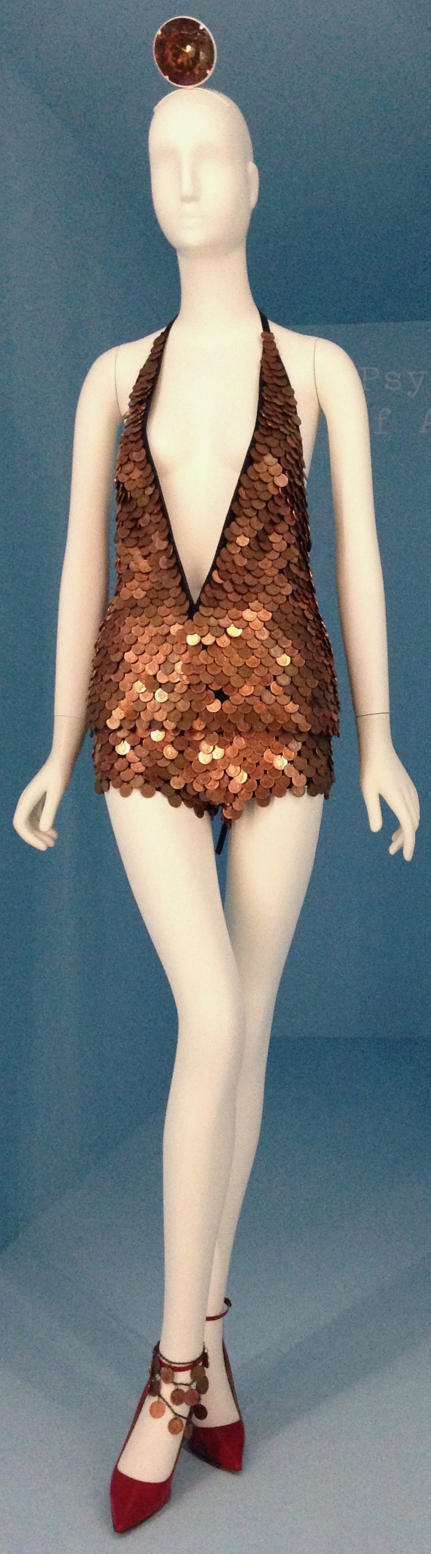 Gareth Pugh, Ensemble, spring/summer 2016, top of black silk faille and black cotton-silk net embroidered with copper meal coins; shorts of black cotton twill embroidered with copper metal coins