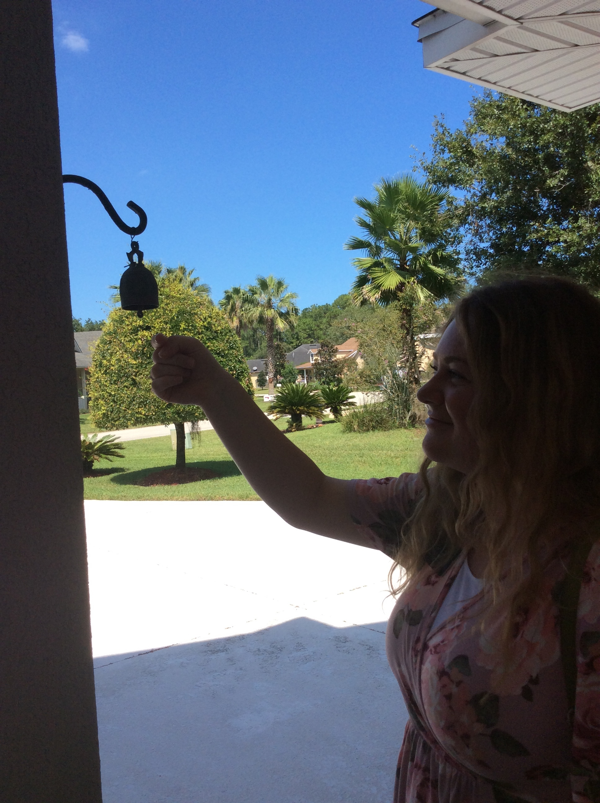 They have these cutie bells on almost all of the porches. Don't worry, they weren't home when we took this.