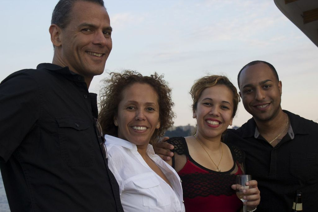 Bookkeeper Lourdes Sierra and husband Louis with paralegal Stephanie Carril and boyfriend Elijah.