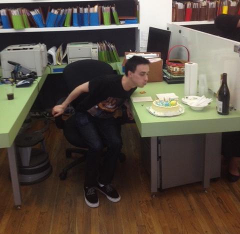 Paralegal Jon Blank celebrates. Will you be sharing that bottle of wine, Jon? (Photo by Matt Bray).