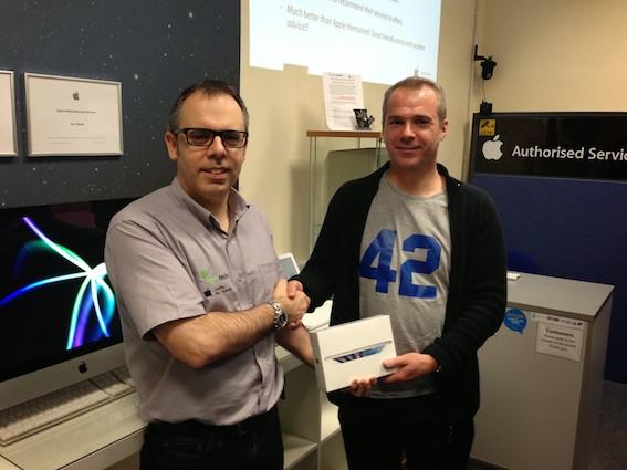 Mike Dent (left) presents Steve Parkman with his iPad prize.