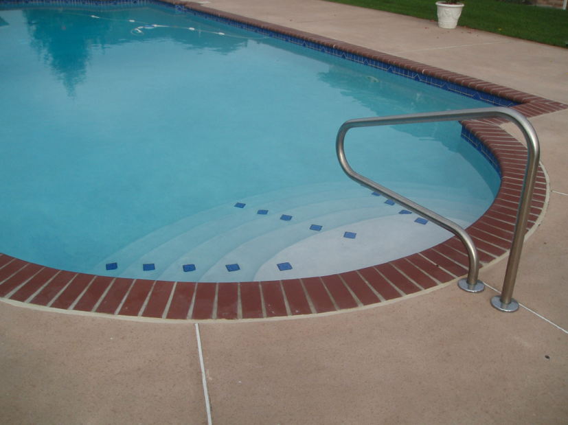 Tri-State project with 3x3 spotter tile trim on steps and 3x3 waterline tile w/diamond medallions. Bullnose Brick Coping, Plantation Red and Diamond Brite interior finish, Super Blue.