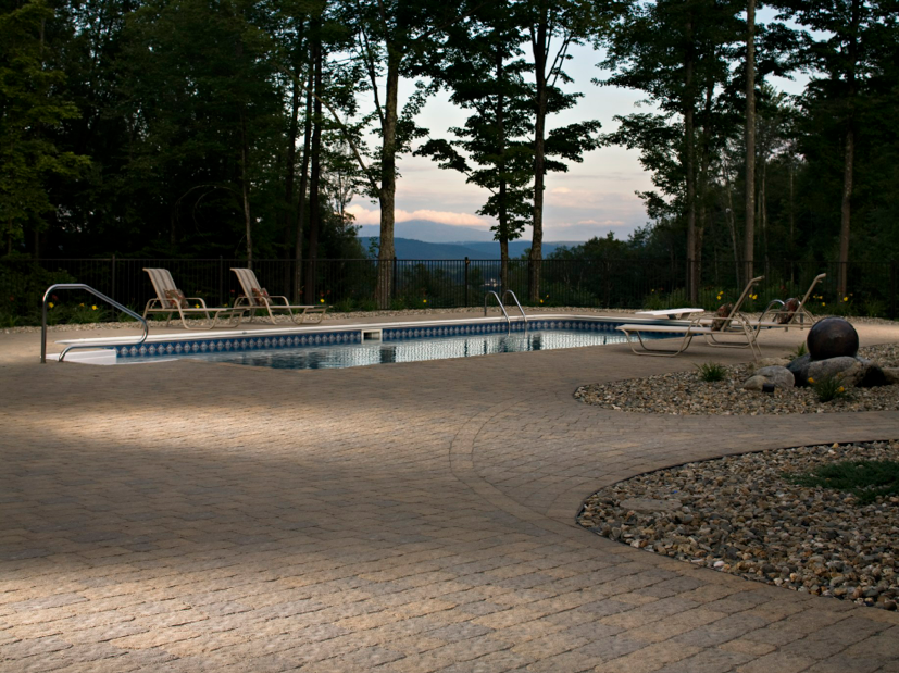 Belgards Bergerac tumbled paver deck and Dublin Cobble 9x9 as pool coping.  This is a great looking paver available in a beautiful range of colors.