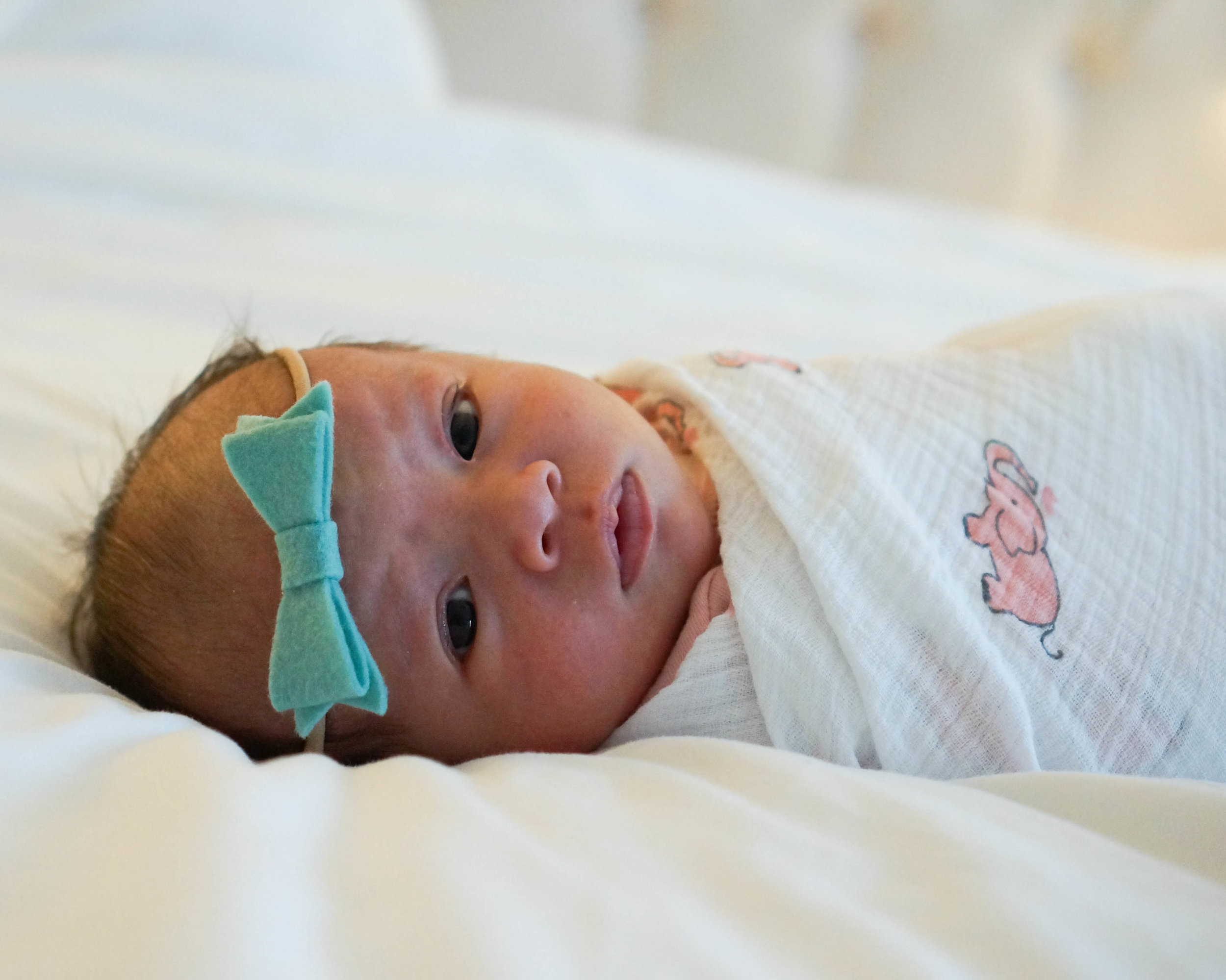 1 Month Old  Headband:  Little Poppy Co ; Swaddle: Aden by Aden and Anais
