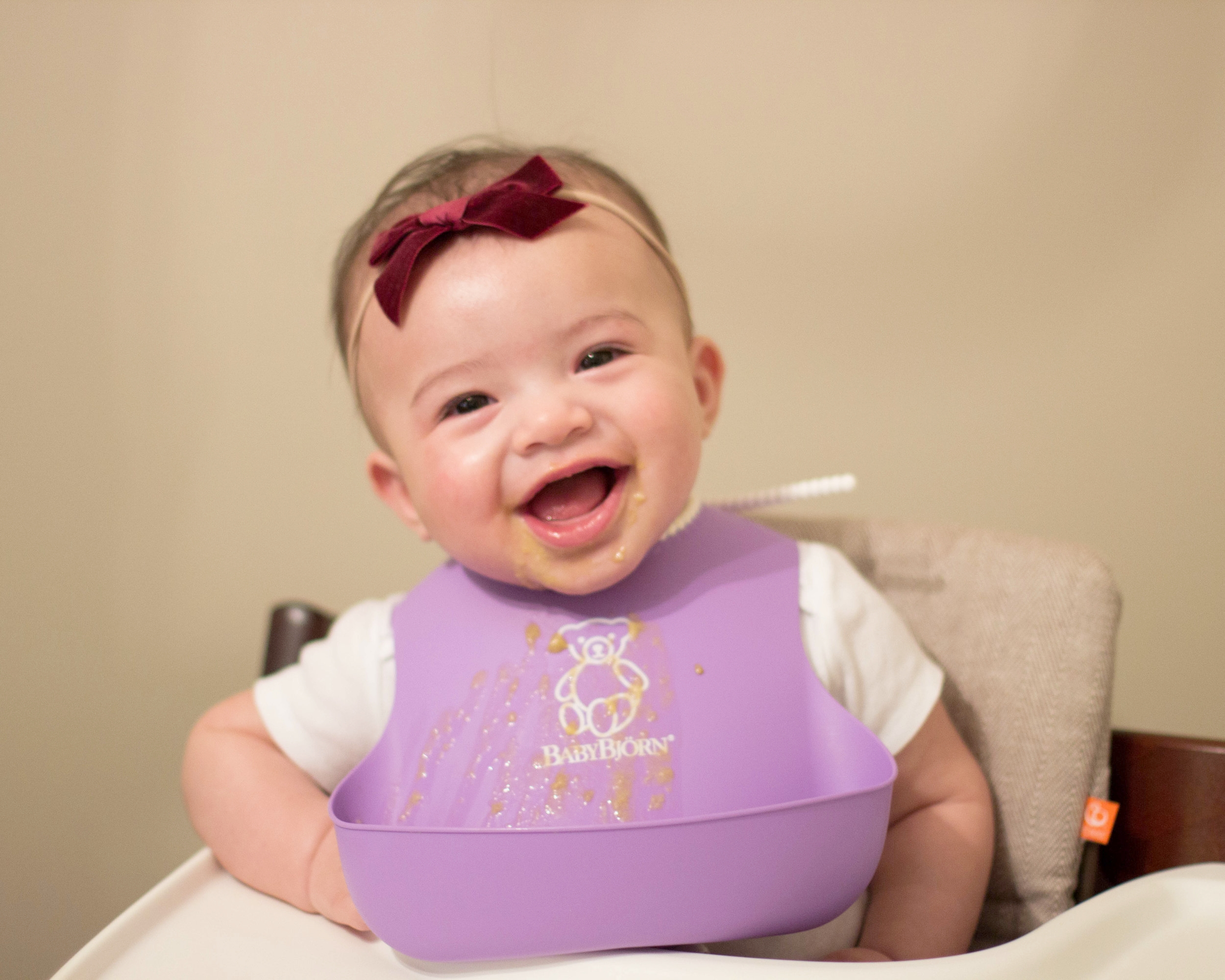 6 Months Old  Headband:  Little Poppy Co ; Bib:  Baby Bjorn ; High Chair:  Stokke