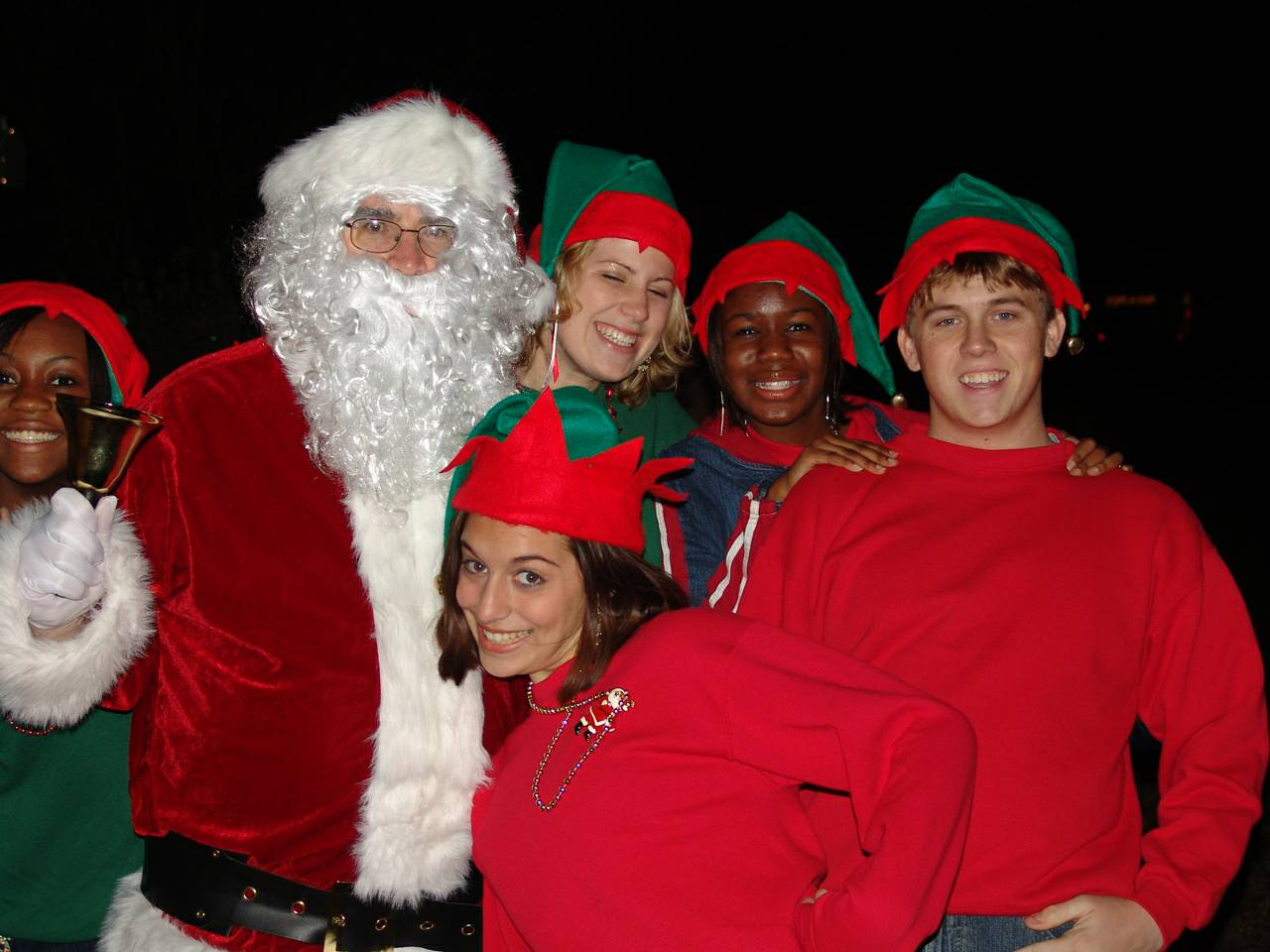 Carolinas Key Club members join Santa Claus to bring joy to the residents of Boys and Girls Homes.