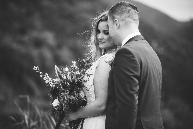 29_KBelope-223_adventurous_holdinghands_blackandwhite_elopementphotographer_elopement_bigsur_blooms_big_sunset_extravaganza_zoe_wandering_burchard_romantic_adventure_b&w_sur_photographer.jpg