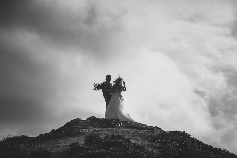 43_KBelope-389_adventurous_holdinghands_blackandwhite_elopementphotographer_elopement_bigsur_blooms_big_sunset_extravaganza_zoe_wandering_burchard_romantic_adventure_b&w_sur_photographer.jpg