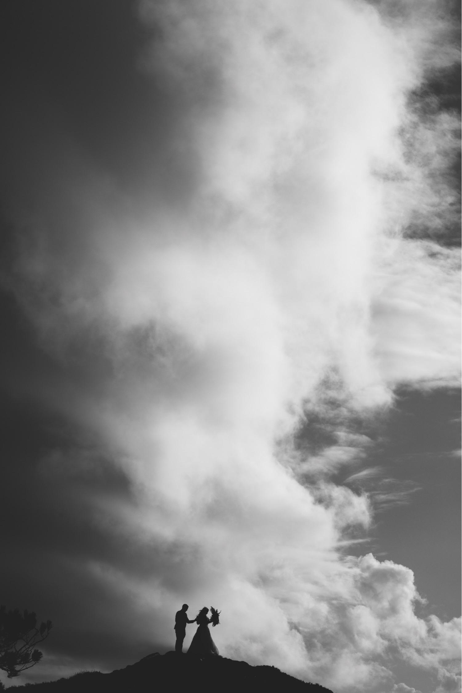 42_KBelope-388_adventurous_holdinghands_blackandwhite_elopementphotographer_elopement_bigsur_blooms_big_sunset_extravaganza_zoe_wandering_burchard_romantic_adventure_b&w_sur_photographer.jpg
