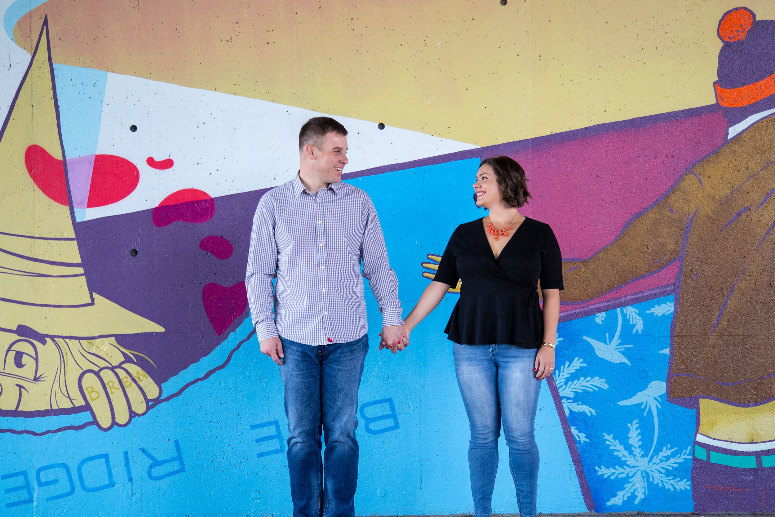 Mural-Roanoke-Downtown-Couple-Pastel-engagement-wedding-photo-shoot-hand-holding-love-virginia-photographer-washington-DC-painting