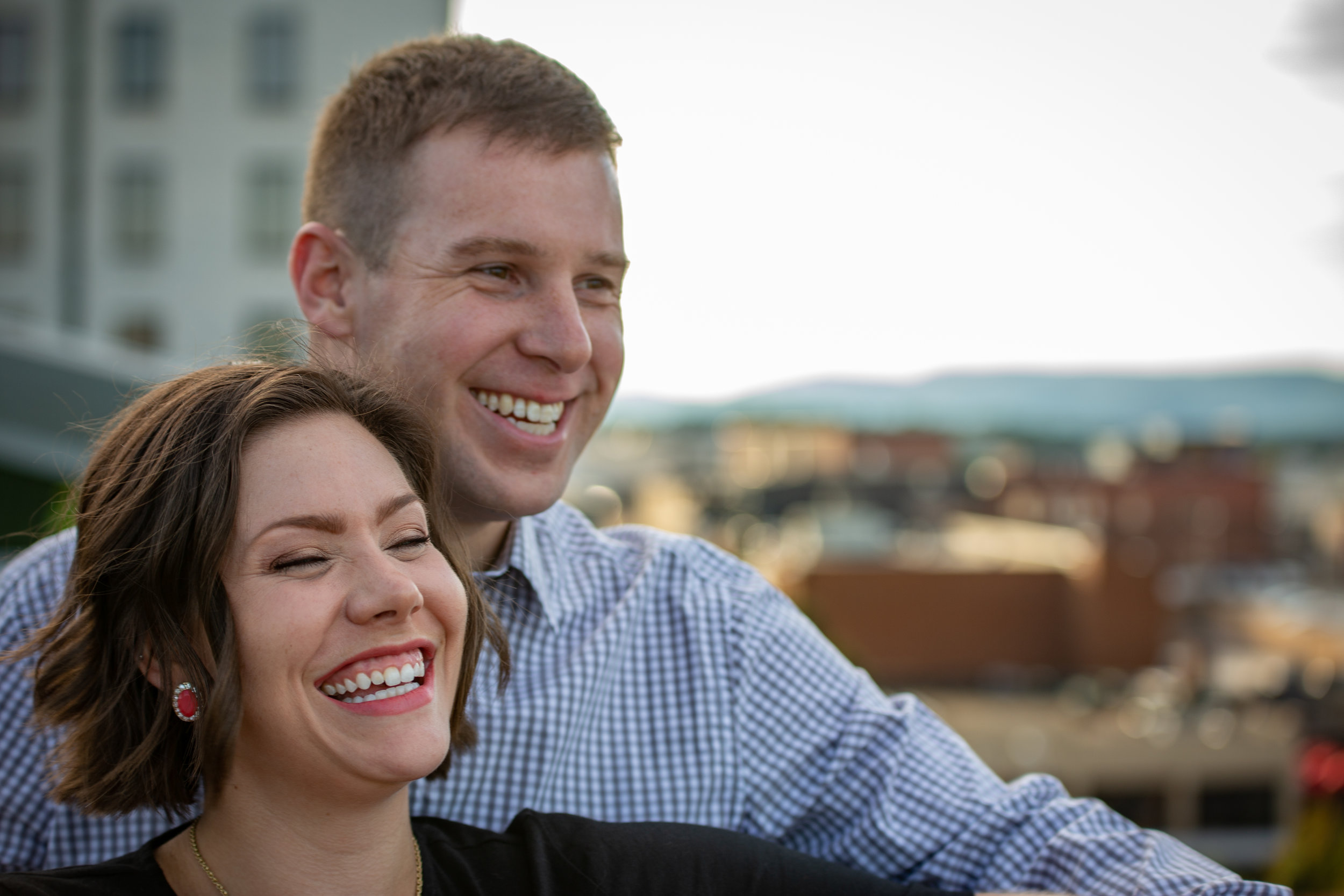 center-in-the-square-downtown-roanoke-urban-rooftop-engagment-wedding-love-couple-smiling-laughing-engaged