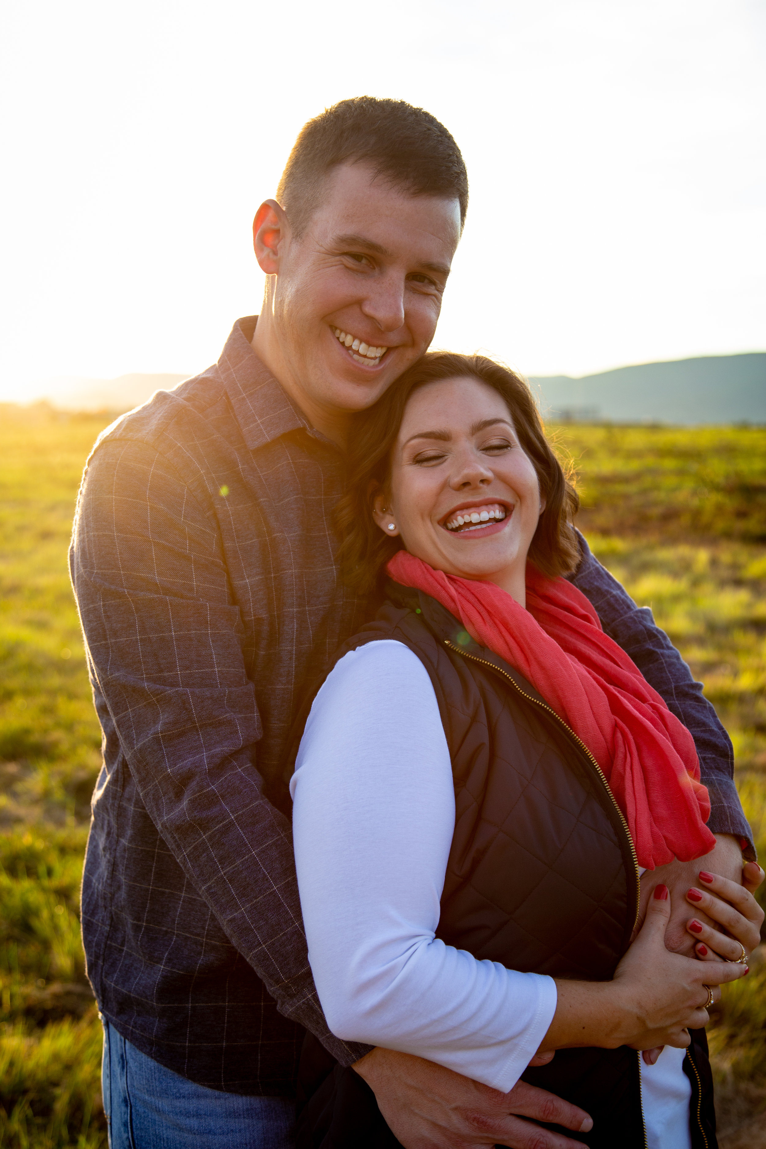valley-view-shakers-roanoke-engagment-love-couple-outside-sun-flare-warm-love-smile-laughing-mountains